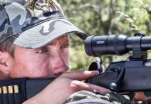 imagen de cazador con rifle