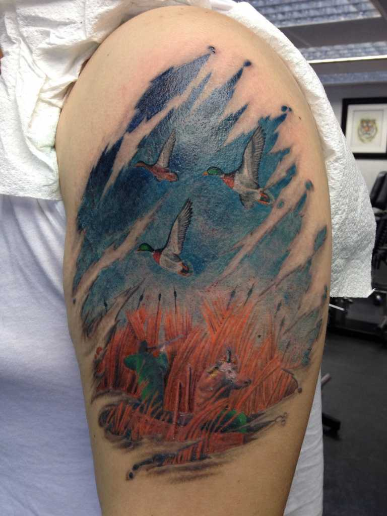 color-ink-flying-ducks-and-wild-animals-hunting-tattoo-on-left-half-sleeve