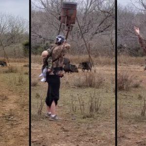 Una madre caza a un jabalí con arco mientras lleva a su bebé a la espalda
