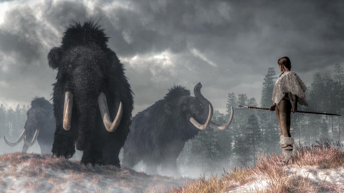 Recreación de una cazadora frente a unos mamut. ©Shutterstock