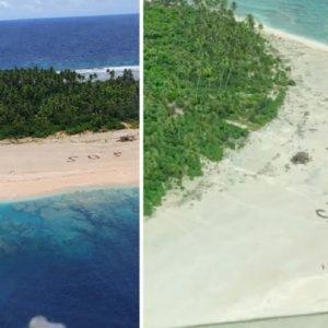 Rescatan a tres pescadores que naufragaron y dibujaron un gigantesco SOS en la arena de una playa